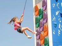 young girl on an outdoor climbing wall