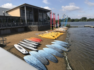kayaks and canoes on the beach side of gunwade lake ready for hire