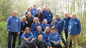Group of volunteers being photographed on the boardwalks in bluebell woods