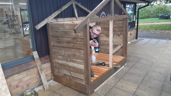 apprentice isaac building a wood shed