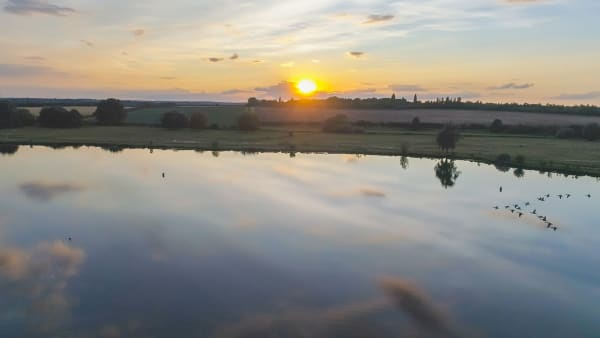 ariel view of the sunset overlooking the lake in ferry meadows